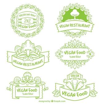 Insignias de restaurante vegano verde dibujados a mano