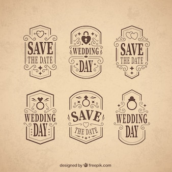 Insignias del día de boda ornamentales en estilo vintage