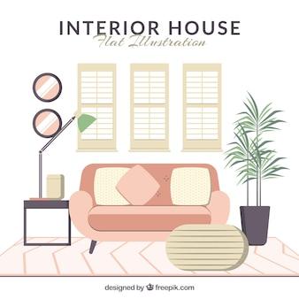 Interior de casa plana con sofá rosa