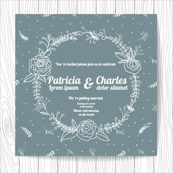 Invitación de boda con corona de flores y fondo con patrón de hojas