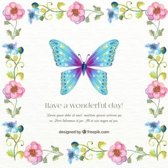 Invitación de mariposa pintada a mano con un marco floral