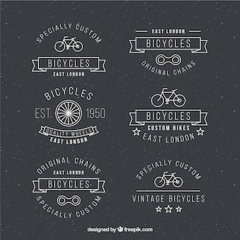 Isnignias de bicicletas dibujadas a mano en diseño retro