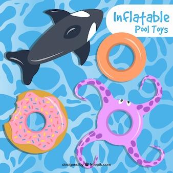 Juguetes inflables divertidos en la piscina