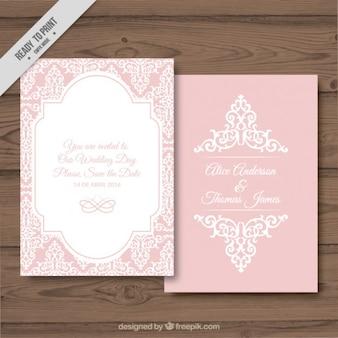 la tarjeta de boda sobre un fondo de color rosa