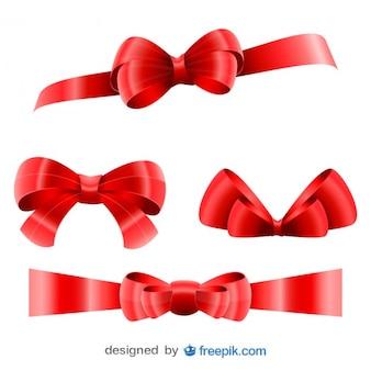 Lazos grandes de Navidad rojos en conjunto