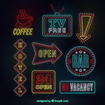 Letreros de señales luminosas de neón con detalles rojos