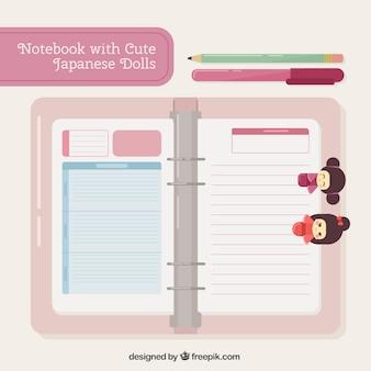 Libreta con bonitas muñecas japonesas y bolígrafos