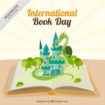 Libro abierto con un dragón alrededor de un castillo