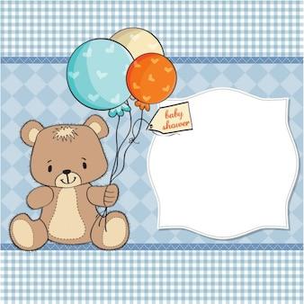 Lindo oso sujetando unos globos para la fiesta del bebé