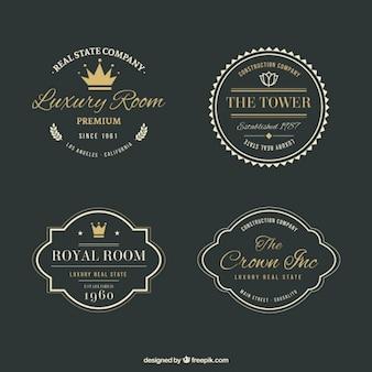 Logos lujosos de inmobiliaria con detalles dorados en estilo vintage