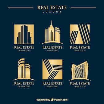 Logos lujosos dorados de inmobiliaria