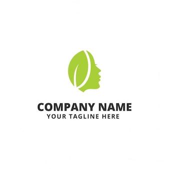 Logotipo con una cara y una hoja