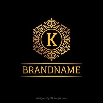 Logotipo de monograma dorado