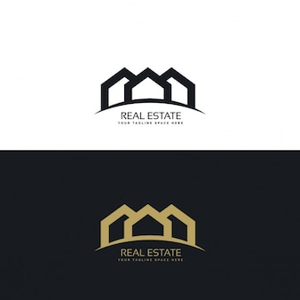 Logotipo inmobiliaria negro y dorado con tres casas