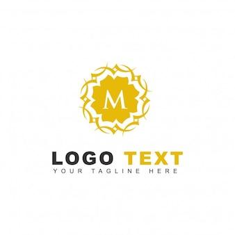 Logotipo ornamental de la letra m