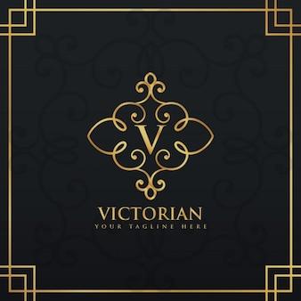 Logotipo ornamental dorado con la letra v