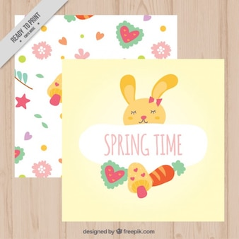 Mano conejito dibujado con los elementos florales tarjetas