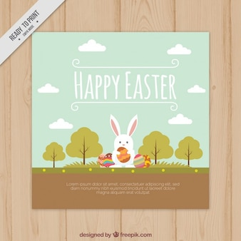 Mano conejito dibujado en una tarjeta de Pascua paisaje