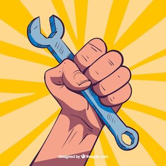 Mano sujetando llave inglesa dibujado a mano