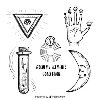 Mano y símbolos de alquimia dibujados a mano