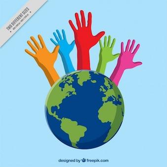 Manos de colores saliendo del mundo