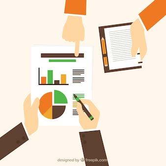 Manos sosteniendo un gráfico de negocios