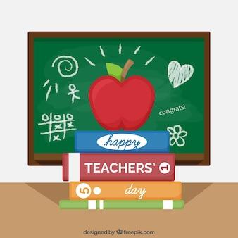 Manzana y libros, día mundial del profesorado