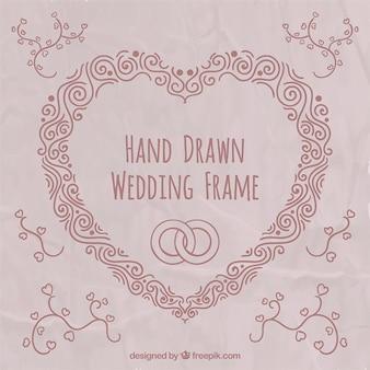 Marco de boda de corazón dibujado a mano