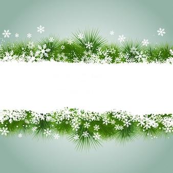 Marco de navidad con copos de nieve e hierba