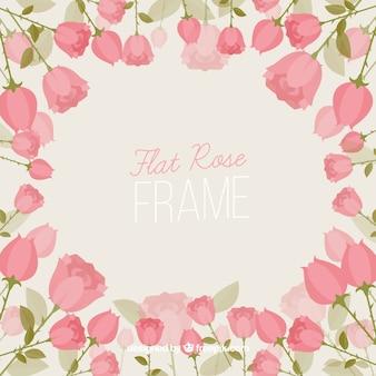 Marco de rosas planas en tonos rosas
