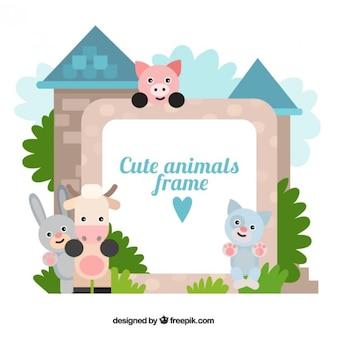 Marco de simpáticos animales con un castillo