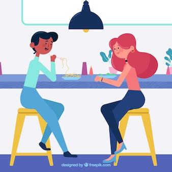 Mejores amigas almorzando en un bar