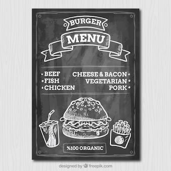 Menú de hamburguesa delicioso en pizarra