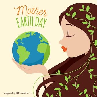 Mujer linda sujetando el planeta tierra