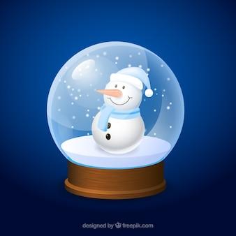 Muñeco de nieve de dibujo animado dentro de una bola de cristal