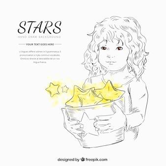 Niña bonita sujetando un cubo con estrellas amarillas