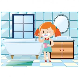 Niña cepillando sus dientes en el baño