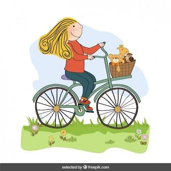 Niña feliz que monta una bicicleta