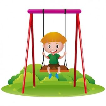 Niño jugando en un columpio