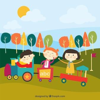 Niños alegres jugando con un tren al aire libre
