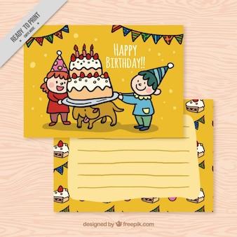 Niños con una tarta de cumpleaños y un perro