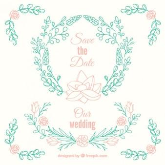 Ornamentos de boda dibujados a mano con hojas y rosas