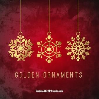 Ornamentos dorados de copos de nieve