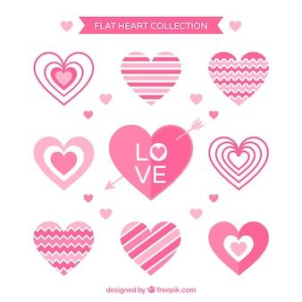 Pack de corazones rosas decorativos en diseño plano