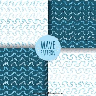 Pack de cuatro patrones con olas dibujadas a mano