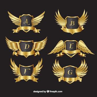 Pack de escudos heráldicos dorados con alas