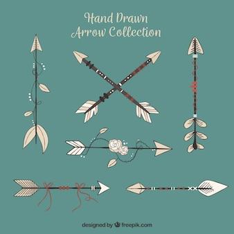 Pack de flechas dibujadas a mano en estilo étnico