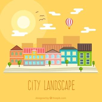 Paisaje de la ciudad al atardecer en diseño plano