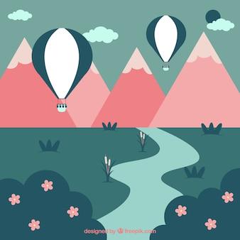 Paisaje de primavera con globos de aire caliente y montañas