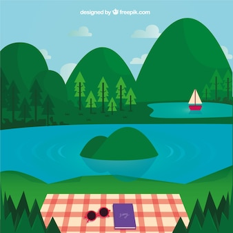 Paisaje de verano, comida campestre al lado del lago